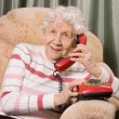 Elderly womspeaks on phone — Stock Photo #5537583