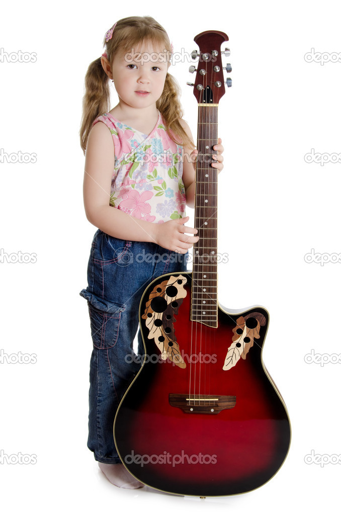 The little girl with an electric guitar  Stock Photo #5537141