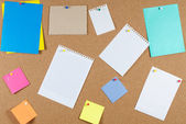 Collection of note papers on corkboard — Stock Photo