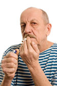 Man in a stripped vest smokes — Stock Photo