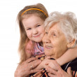 The elderly woman with grand daughter — Stock Photo
