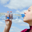 The girl drinks water — Stock Photo