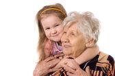 пожилая женщина с внучкой — Стоковое фото