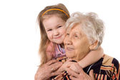 The elderly woman with grand daughter — Стоковое фото