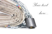 Pile of newspapers with chains — Stock Photo