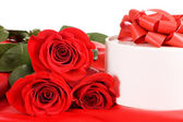Rose with a box with gift — Stock Photo