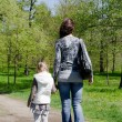 Mum with a daughter on rest in park — Stock Photo