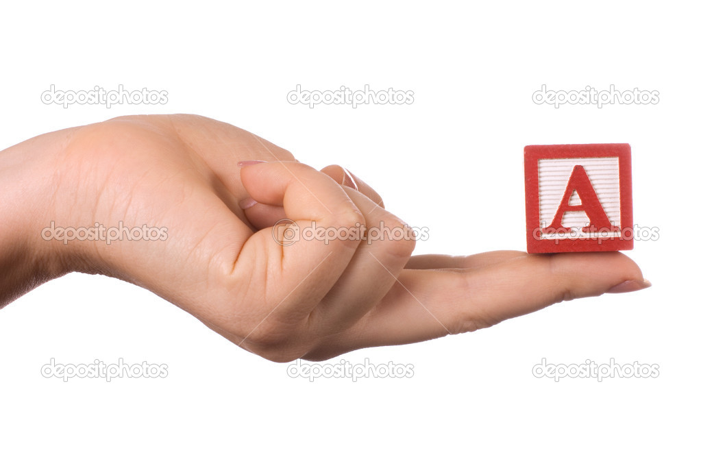 The hand holds a cube with letters — Stock Photo #5663598
