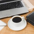 Cup from coffee on the laptop — Stock Photo