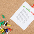 Collection of note papers on corkboard - Stock Photo