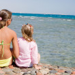Two girls on seacoast — Stock Photo