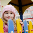 The girl on a children's playground — Stock Photo