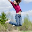 The jumping girl - Stockfoto
