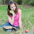 The girl with an apple - Foto Stock