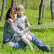 Mum with a daughter on rest in park — Stock Photo #5761936