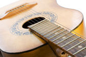 Acoustic guitar isolated on a white — Stock Photo