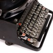 Stock Photo: Old typewriter isolated on white background