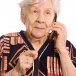 The elderly woman speaks on phone — Stock Photo