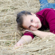 Girl lays on dry grass — Stock Photo #5862300