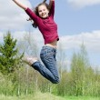 The jumping girl — Stock Photo