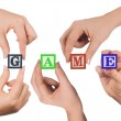 Hand and word Game isolated on white — Stock Photo