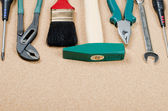 Building tools on a corkboard — Stock Photo
