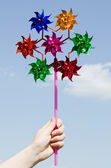 Children's hand holding a toy windmill — Stock Photo