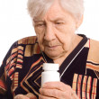 The elderly woman with tablets — Stock Photo #6141109