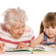 Grandmother with the grand daughter read — Stock Photo #6141117