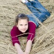 Girl lays on dry grass — Stock Photo #6141131