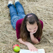 The girl with an apple - Stock Photo