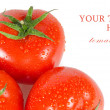 Red tomato isolated on white background - Stock Photo