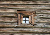 Window in the old wooden house — Stock Photo