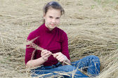 Girl Sits on a dry grass — Stock Photo
