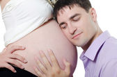 Happy pregnant couple isolated on white — ストック写真
