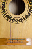 Close-up old acoustic guitar as background — Стоковое фото
