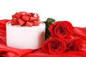 Red rose with a box with a gift — Stock Photo