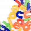 Plastic English letters isolated on white - Stock Photo
