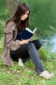 The girl with the book at a pond — Stock Photo