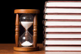 Hourglasses and book — Stock Photo