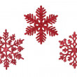 Three red glitter snowflakes — Stock Photo