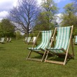Stock Photo: Deck chairs in a park