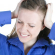 Woman with headache holding her hands to the head — Stock Photo #5551826