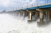 Reset of water at hydroelectric power station on the river — Stock Photo