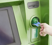 Female inserts a plastic card in the ATM — Stock Photo