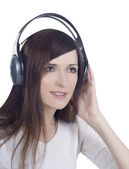 Young woman in headphones listening music — Foto Stock