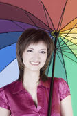 Beautiful woman with colorful umbrella — Stock Photo