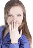 Bright picture of young woman with hands over mouth — Stock Photo