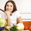 Beautiful woman in the kitchen — Stock Photo #5399831