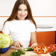 Stock Photo: Beautiful caucasian woman in the kitchen